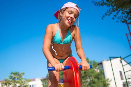 Photo pour Little adorable girl play on toy horse - image libre de droit