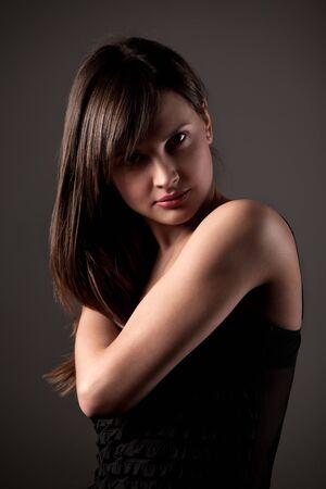 Photo pour Portrait of girl on dark gray background - image libre de droit
