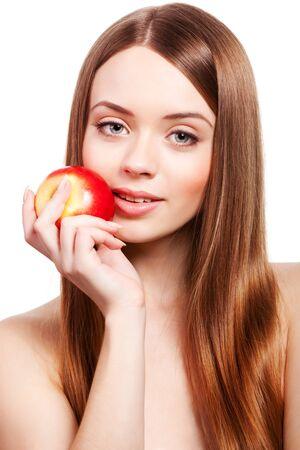 Foto de Beautiful girl with long brown hair holding apple - Imagen libre de derechos