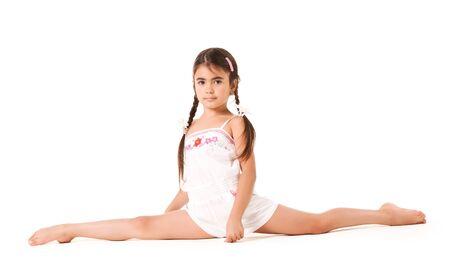 Photo pour A little girl sits on a twine on a white background - image libre de droit