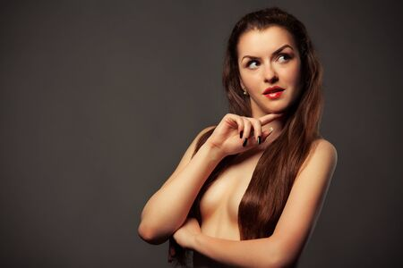 Photo for Portraits of a beautiful caucasian young slender brown-haired topless girl on a gray background. Concept stylish photo shoot. Advertising space - Royalty Free Image