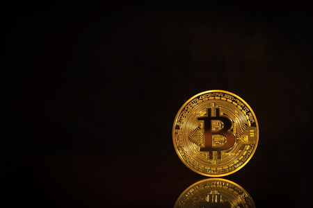 Photo Golden Bitcoins On Black Background. Trading Concept Of Crypto Currency