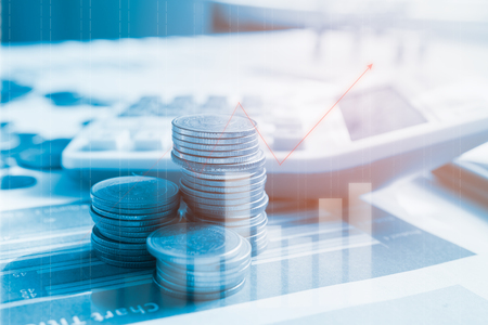 Photo pour Step of coins stacks on financial report with calculator, profit graph of stock market trade indicator financial.Double exposure style - image libre de droit