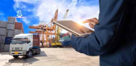 Foto de Business Logistics concept, Businessman manager using tablet check and control for workers with Modern Trade warehouse logistics. Industry 4.0 concept - Imagen libre de derechos