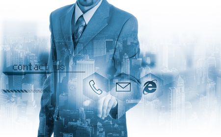 Businessman pressing virtual phone buttons. customer support concept.