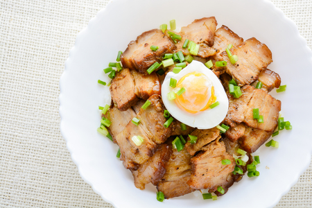 Photo for Bowl of rice topped with Braised pork belly and boiled egg, Japanese called Kakuni-don - Royalty Free Image