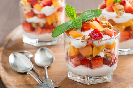 Photo for fruit dessert with whipped cream, mint and granola, close-up, horizontal - Royalty Free Image