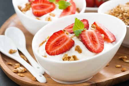 healthy breakfast - yogurt with fresh strawberries and granola, close-up, horizontal