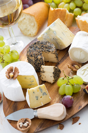 cheese platter, snacks, bread and wine, vertical, top view
