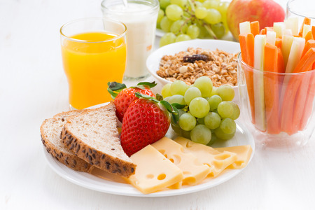 Foto de healthy and nutritious breakfast with fresh fruits and vegetables on white table, close-up, horizontal - Imagen libre de derechos