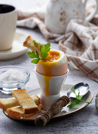 Soft-boiled egg and toasts. Selective focus