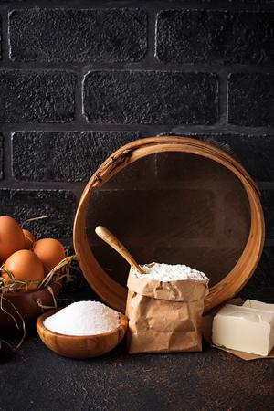 Photo pour Ingredients for baking. Butter, eggs, sugar and  flour. Selective focus - image libre de droit
