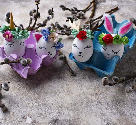 Photo for Easter handmade eggs in shape of bunny, cat, unicorn and deer - Royalty Free Image