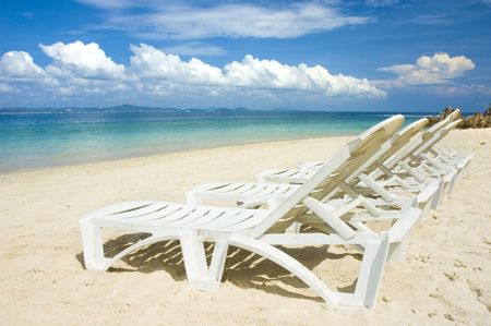 blue beach with chairs