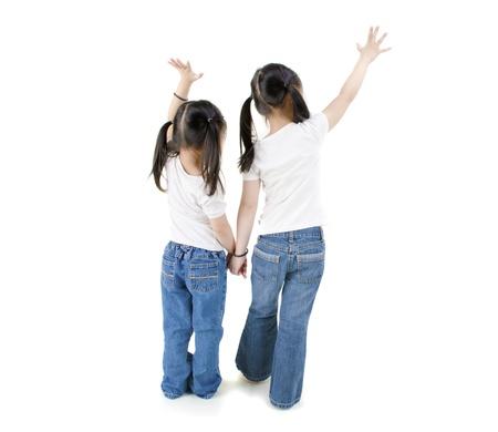 isolated asian girls raising hands, full body