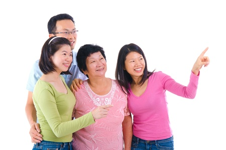 happy asian family pointing at somewhere