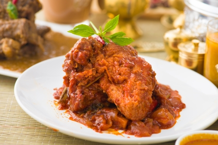 curry chicken rendang cooked in indian style with spicy sauce and chilli