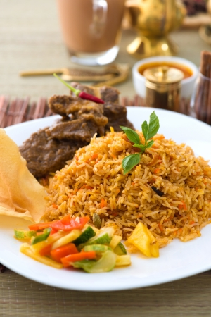 Mutton Biryani rice with traditional items on background