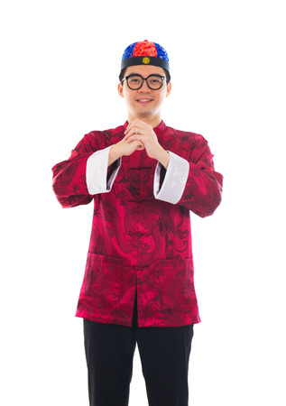 Asian man with Chinese traditional dress cheongsam and gong xi fa cai greetings