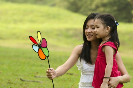 Photo for Attractive Mother and daughter spending time together in the park   - Royalty Free Image