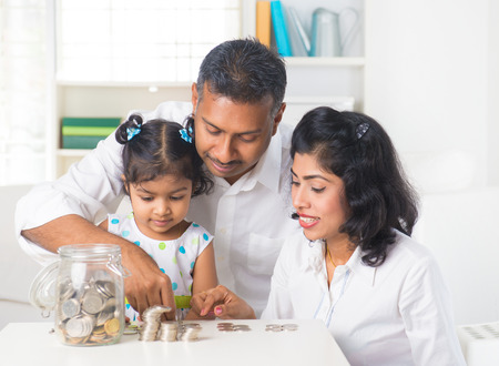 indian family teaching children on savings and financial planning