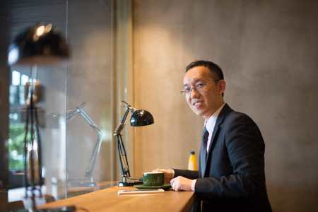 asian business man having coffee