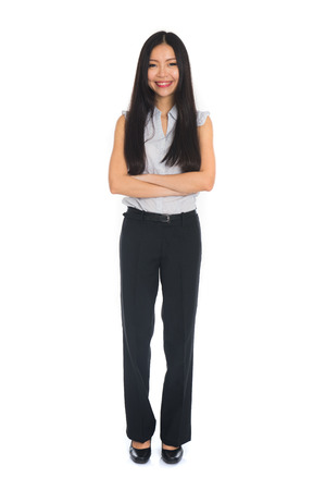 Business woman standing in full length isolated on white background. Beautiful mixed race Chinese female mode in suit.の写真素材