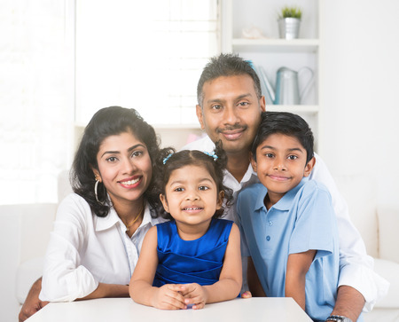 portrait photo of happy indian family