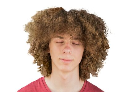 Photo pour portrait of a young curly European man with long curly hair and closed eyes close up dreaming. very lush male hair. curling hair for men. a lock of passion. isolated on white background. - image libre de droit