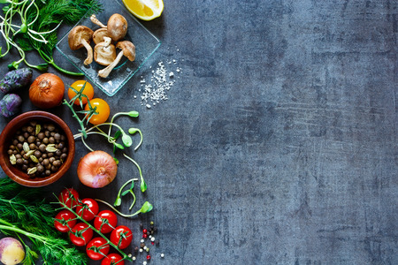 Garden vegetables with fresh ingredients for healthily cooking on vintage background, top view, banner.