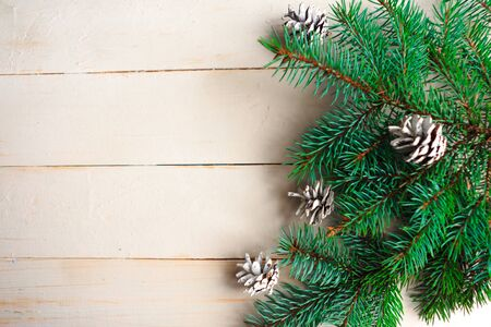 Foto de Spruce branches with pinecones on wooden background. Flat lay, top view, copy space - Imagen libre de derechos