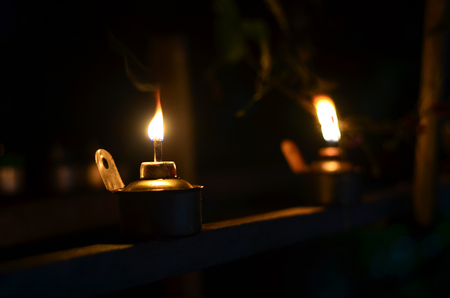 Photo for Traditional kerosene lamp light  also known as pelita isolated in a dark background. - Royalty Free Image