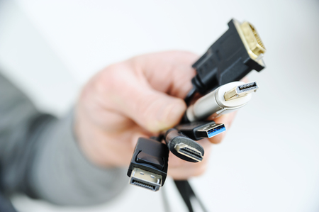 Photo pour There are various cords and plugs in the hand of a man. - image libre de droit