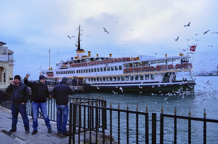 Istanbul, Turkey - December 22, 2012: Istanbul Ferries  (called vapur in Turkish) continue to serve as a key public transport link for many Thousands of commuters, tourists and vehicles per day. Seagulls are everywhere in Istanbul and a tradition of feedi