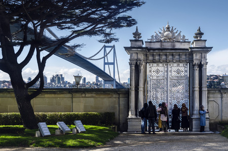 Istanbul, Turkey - March 28, 2015: Beylerbeyi Palace. Visitors watching the landscape palace gates. The Beylerbeyi Palace (Turkish: Beylerbeyi Sarayi), Beylerbeyi meaning Lord of Lords, is located in the Beylerbeyi neighbourhood of Uskudar district in I
