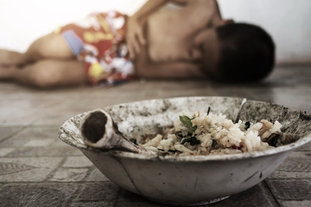 Causes of food poisoning, blurry of little boy lay down after eating moldy rotten food on ground with gradient and shadow edge, poverty and lacking concept