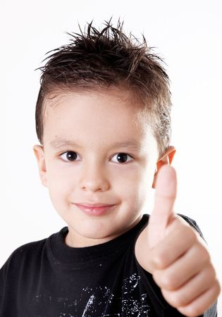 5 years old child doing a positive signal with his hand.ok attitude