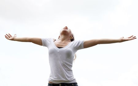Young woman with outstretched arms expressing freedom