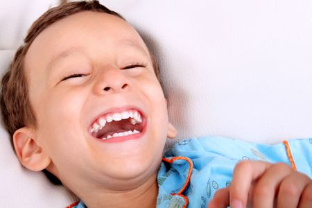 Photo pour Four years old boy laughing over white background. Happiness concept - image libre de droit