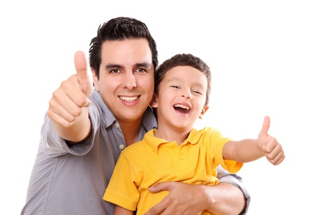 Father and son having fun with a wave of positivism