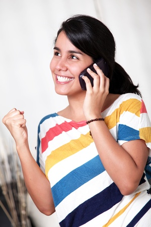 Young girl with positive attitude talking on mobile phone
