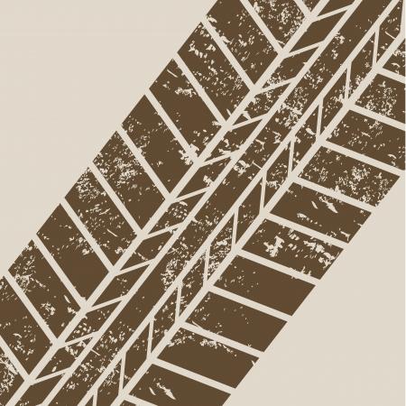 tire tracks over beige background