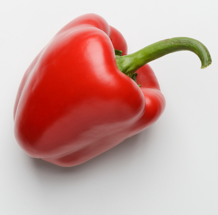 Foto per Red bell pepper on white - Immagine Royalty Free