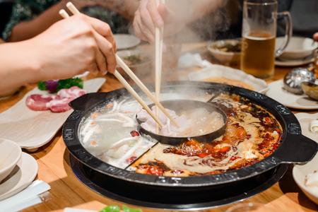Photo pour Family eating a hot pot - image libre de droit