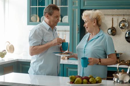 Photo pour Retired couple having a breakfast - image libre de droit