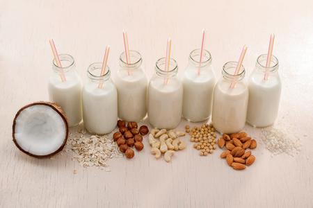Photo pour Bottles of assorted vegan milks - image libre de droit
