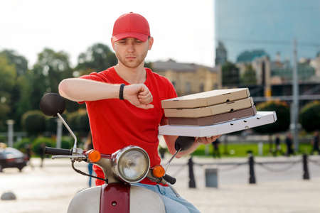 Portrait of a man delivering pizza on time