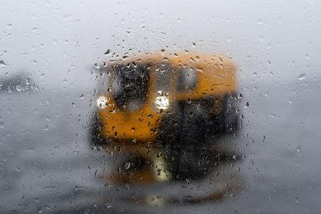 Foto de View on a yellow all-terrain vehicle through misted glass - Imagen libre de derechos