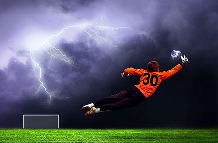 Football goalman on lightning sky