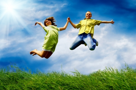 Photo for Fun couple in jump on the outdoor background - Royalty Free Image